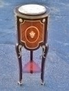 Elegantly inlaid and ornate marble top stand side table